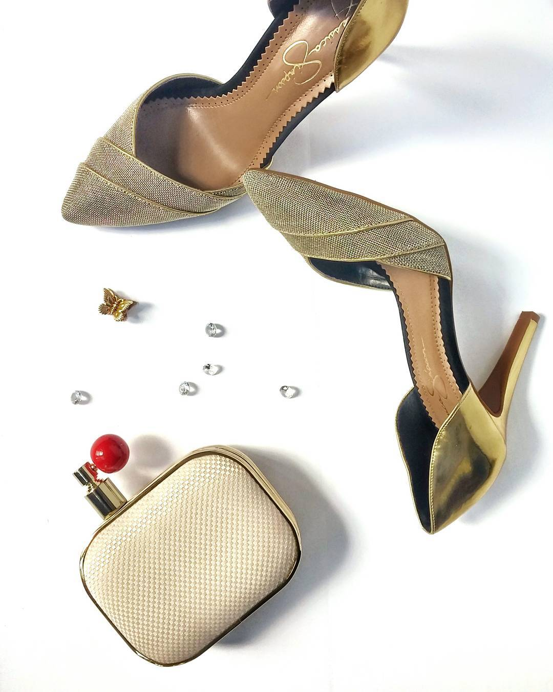 Last post for this #WeddingWednesday... Throw back to 3 items that kept me going on my wedding day:  My @jessicasimpsonstyle pumps... these were shoe 2 of 2 for the eve  The ever adorable, constantly complimented on @mindesign_ca perfume bottle shaped clutch that held my lipbalm, eyeliner, and a little sanity at the bottom  @zivadesigns keepsake for my something old, from early high school years, it still makes me tear up <3